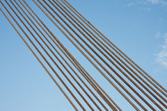 Steel cables against a blue sky Stock Images