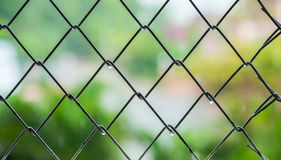 Steel cage with blur background Stock Images