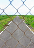 Steel cage in front of the street. Stock Image
