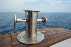 Steel capstan on side of a yacht at sea Stock Images