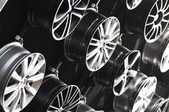 Steel car rims. Auto steel alloy car rims over a dark background Stock Photography