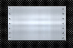 Steel and carbon fibre. Great image steel plate on carbon fibre Royalty Free Stock Photos