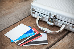 Steel case and credit cards on floor Royalty Free Stock Images