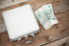 Steel case with Russian rubles laying on timber Royalty Free Stock Photo