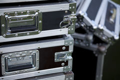 Steel cases. Three black cases with handles Stock Image
