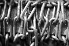 Steel Chain in black and white. Steel chains expressing the strength and drama of black and white Royalty Free Stock Photography