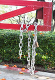 Steel chain cross lock on red road barrier Stock Photo
