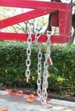 Steel chain cross lock on red road barrier. Steel chain cross lock padlock on red road barrier Stock Photo
