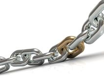 Steel chain with a golden link Royalty Free Stock Image