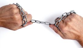A steel chain in the hands royalty free stock image