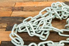 Steel chain. On wooden background. Macro shot Stock Photography