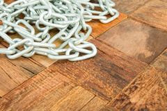 Steel chain. On wooden background. Macro shot Royalty Free Stock Photography