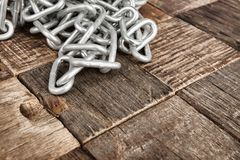 Steel chain. On wooden background. Macro shot Stock Image