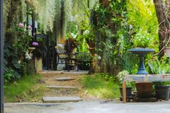 Steel chair in front of coffee shop. Amidst green trees. royalty free stock images