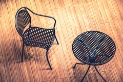 Steel chair and table on wooden floor : top view Royalty Free Stock Images