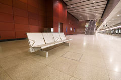 Steel chair in train station. Steel chair in a large lobby in hong kong Royalty Free Stock Images