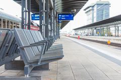 The steel chairs on the platform in train station Royalty Free Stock Photo