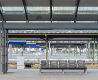 The steel chairs on the platform in train station Royalty Free Stock Photography
