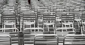 Steel chairs without viewers into an open-air cinema Royalty Free Stock Image