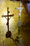 Steel Christian cross. With shadow on old brick wall Stock Photography