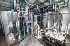 Steel chrome cisterns. Yeast mixture preparation system. Royalty Free Stock Photography