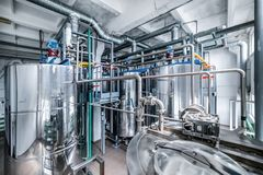 Steel chrome cisterns. Yeast mixture preparation system. Royalty Free Stock Photos