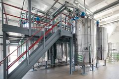 Steel chrome cisterns. Yeast mixture preparation system. Royalty Free Stock Image