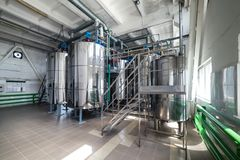 Steel chrome cisterns. Yeast mixture preparation system. Royalty Free Stock Photo