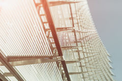 Steel or chrome and glass abstract facade of office building. Steel or chrome and glass abstract facade of an office building and blue sky, sunny day, tilt-shift Royalty Free Stock Image
