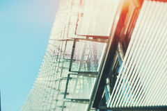 Steel or chrome and glass abstract facade of office building. And blue sky, sunny day, tilt-shift shooting Royalty Free Stock Photos