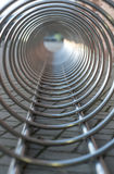 Steel chrome spiral bicycle parking place Stock Photo