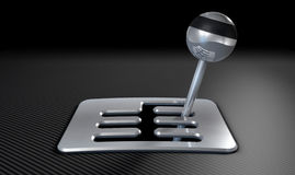 Steel And Chrome Stick Shift. A steel chrome and carbon fibre gear stick shift with an exposed plate on a carbon fibre surface Royalty Free Stock Image