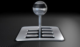 Steel And Chrome Stick Shift. A steel chrome and carbon fibre gear stick shift with an exposed plate on a carbon fibre surface Stock Images