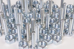 Steel chromeplated bolts. On white background Stock Photography