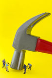 Steel claw hammer on yellow background with small mini miniature Stock Photography