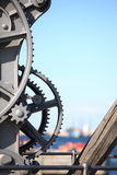 Steel cog wheels metal gears mechanical ratchets Royalty Free Stock Photo