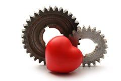 Steel cogwheels and heart Royalty Free Stock Photos