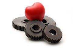 Steel cogwheels and heart Stock Photos