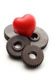 Steel cogwheels and heart Royalty Free Stock Photo