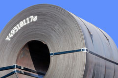 Steel Coil Close-Up. A close-up of the end of a steel coil. Unprocessed steel sheet comes in large coils, it is then rolled in a machine to make steel roofing Royalty Free Stock Photo