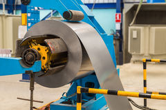 Steel coil on machine Royalty Free Stock Photography