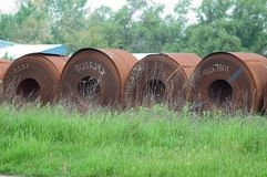 Steel Coils. Stored outside waiting for processing royalty free stock photography