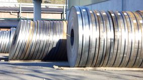 Steel Coils. Rows of Steel Coils at an industrial Factory Stockyard royalty free stock image