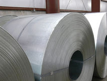 Steel coils. Close-up of steel master coils in warehouse royalty free stock images