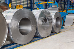Steel coils. Cold rolled steel coils in storage area ready to feed to machine in metalwork manufacturing Royalty Free Stock Photo
