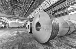 Steel coils inside a factory Stock Photos