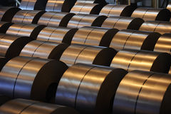 Steel coils. Rolled coils of steel sheets in a steel factory stock images
