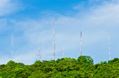 Steel communication antenna from tree to sky Royalty Free Stock Image
