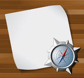 Steel compass and white paper over wooden background Royalty Free Stock Photo