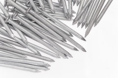 Steel concrete nails. On white background Royalty Free Stock Photos